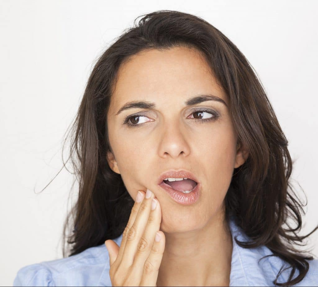 Woman Holding Jaw Jaw Pain